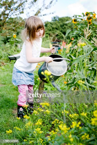 Girl Watering Plants Outside Stock Photo Getty Images