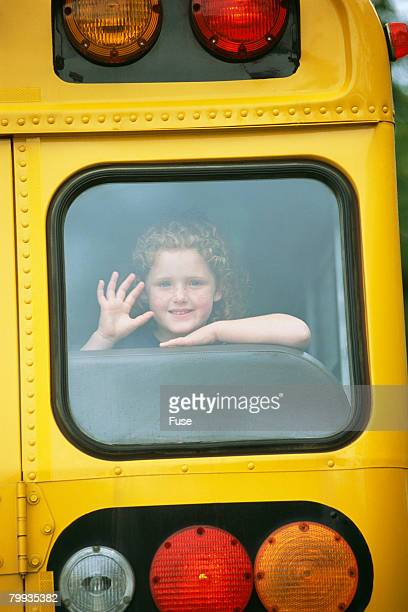 Girl Waving from School Bus