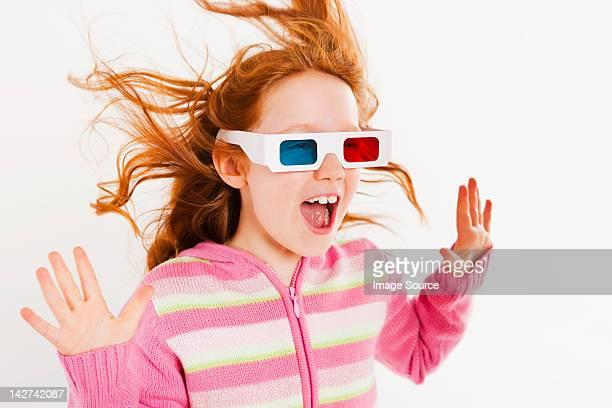 Girl wearing 3D glasses