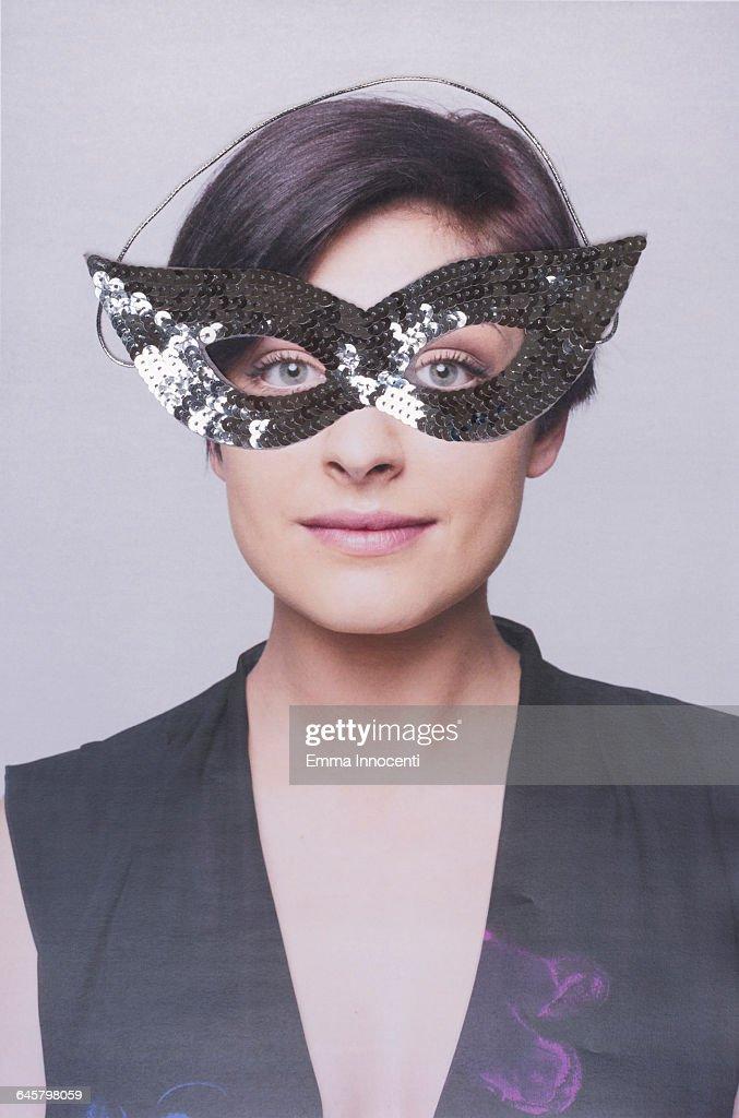 Girl wearing a carnival mask