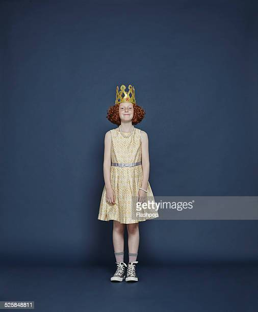 Girl wearing a gold crown