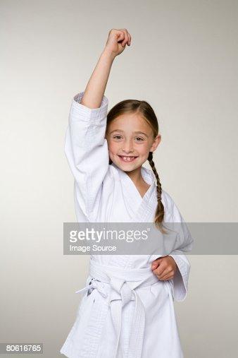 A girl wearing a karate uniform