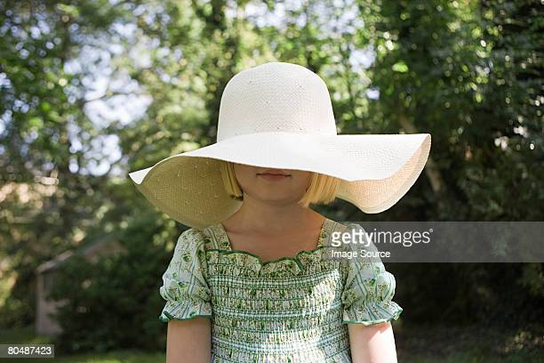 Girl wearing a large sun hat