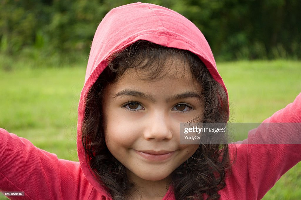 Girl wearing a pink hoodie : Stock Photo