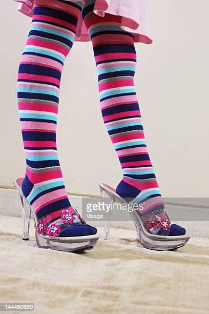 Girl wearing an woman's sandals