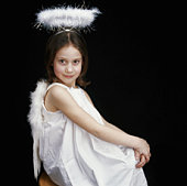 Girl (4-6) wearing angel costume, portrait