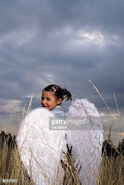 Girl wearing angel wings.