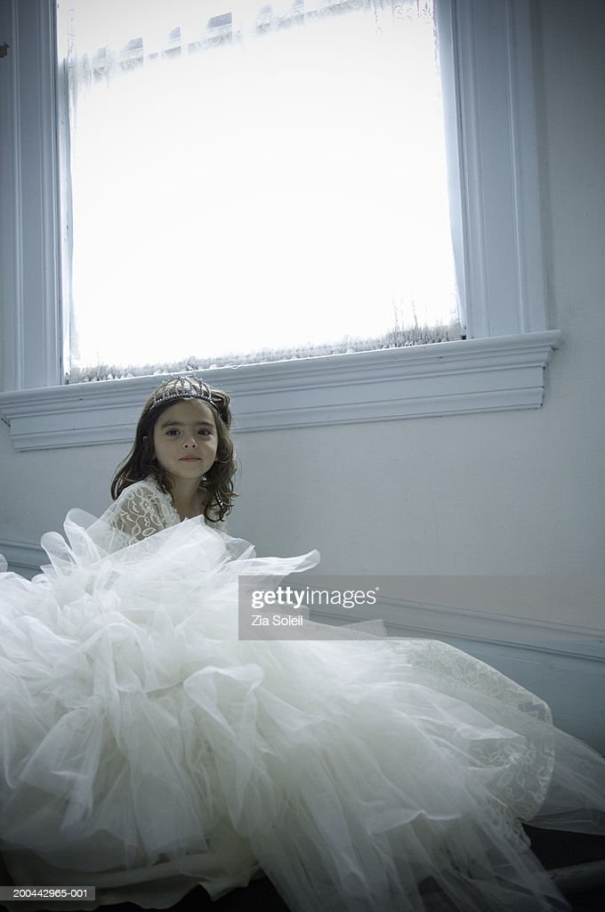 Girl (4-6) wearing bridal gown and tiara, portrait