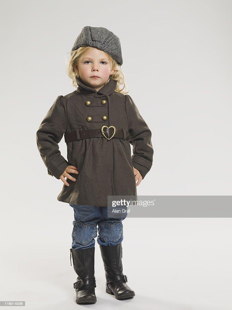 Girl wearing coat and rainboots : Stock Photo