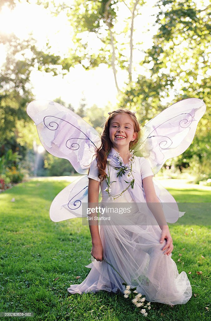 Girl (8-10) wearing costume with wings