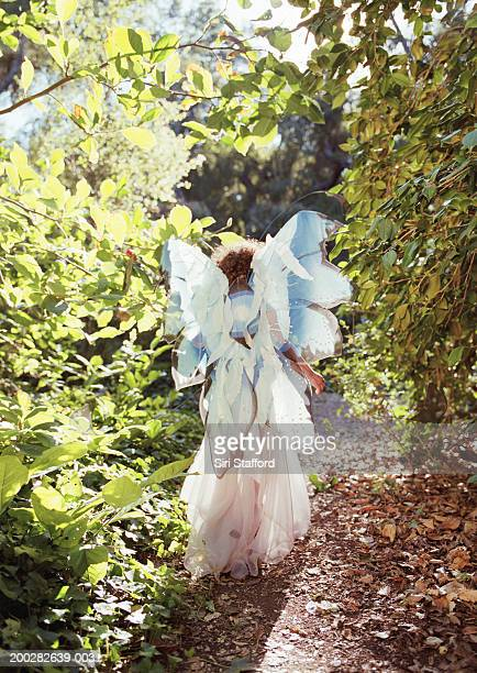 Girl (3-5) wearing costume with wings, rear view