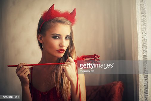 girl wearing devil dress
