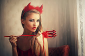 girl wearing devil dress