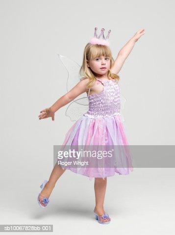 Girl (2-3 years) wearing fairy princess costume dancing, portrait, studio shot