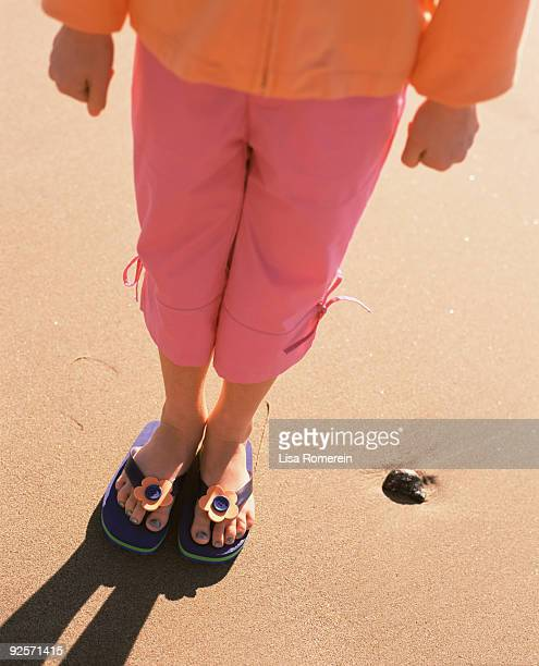 Girl wearing flip-flops