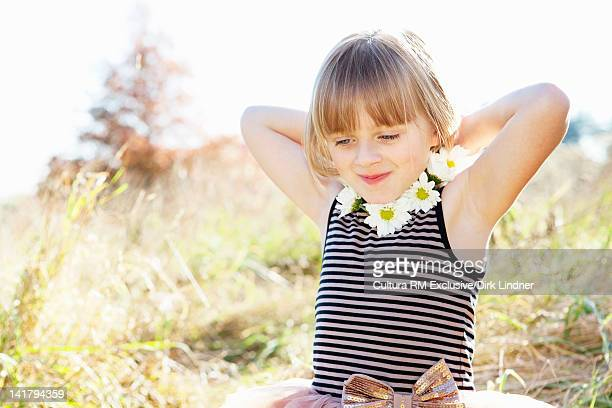 Girl wearing flower necklace outdoors
