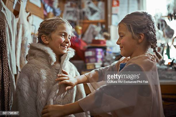 Girl wearing fur coat theatre costume backstage