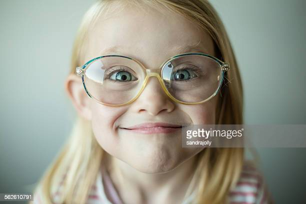 Girl wearing glasses making a silly face