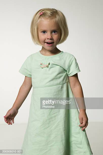 Girl (4-5) wearing green dress, portrait