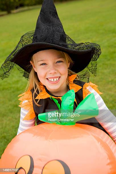 Girl wearing Halloween costume outdoors