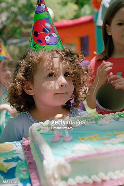 Girl wearing hat at birthday party