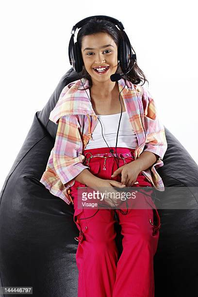 A girl wearing headphones and listening to music