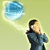 Girl (8-10) wearing headphones, globe above head (Digital Composite)