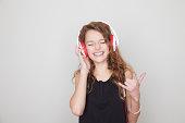 Girl wearing headphones with eyes closed