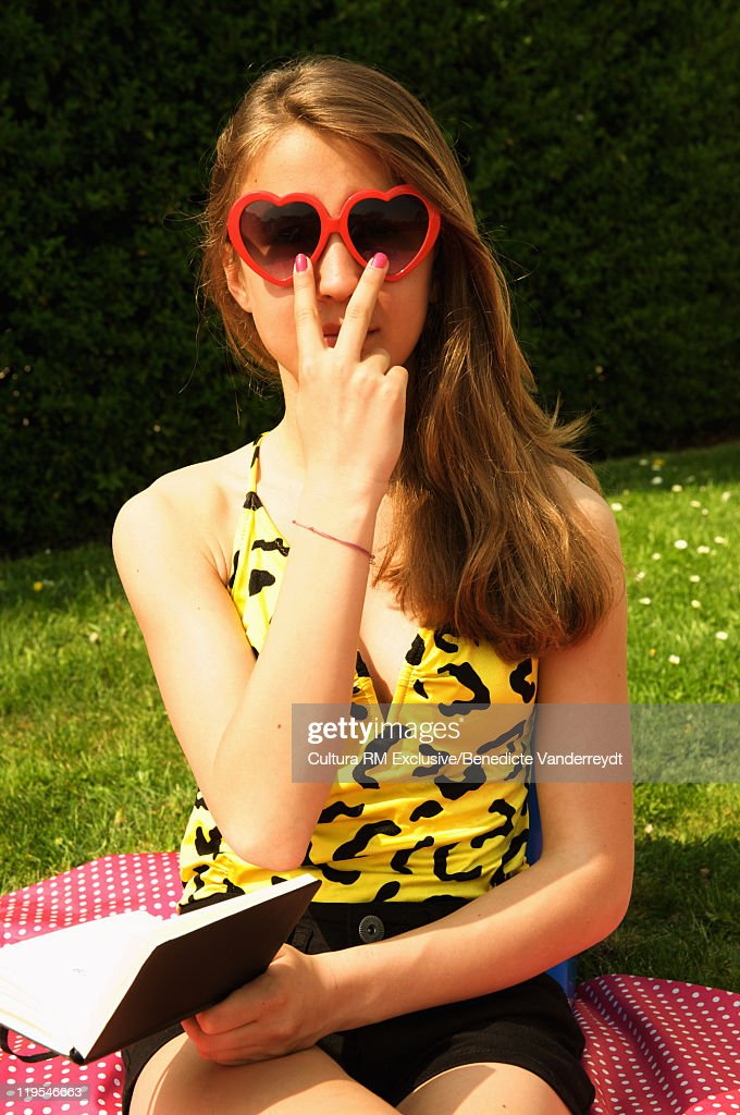 Girl wearing heart sunglasses : Stock Photo