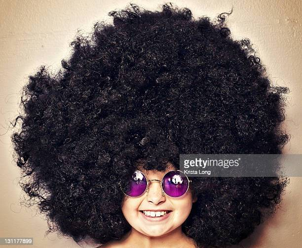 Girl wearing large black wig