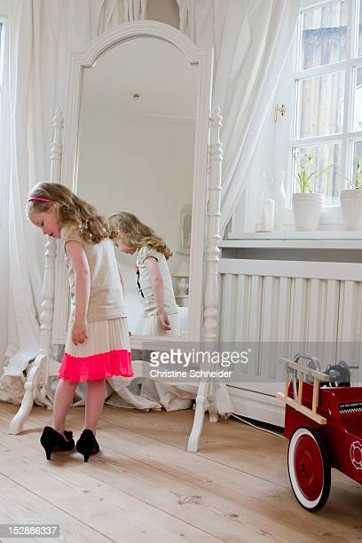 Girl wearing mothers high heels