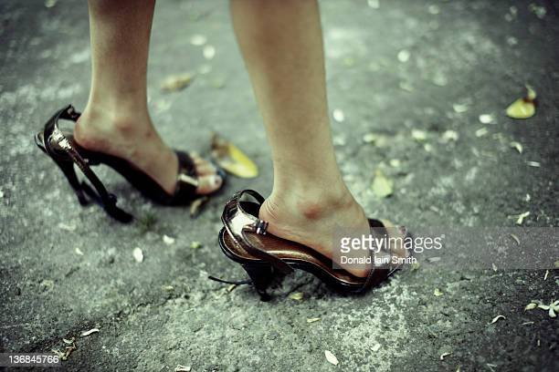 Girl wearing mums shoes