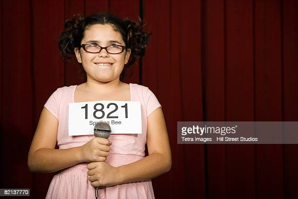 Girl wearing number on stage