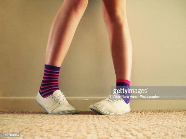 Girl wearing odd socks