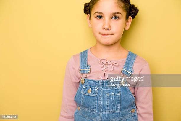 Girl wearing overalls