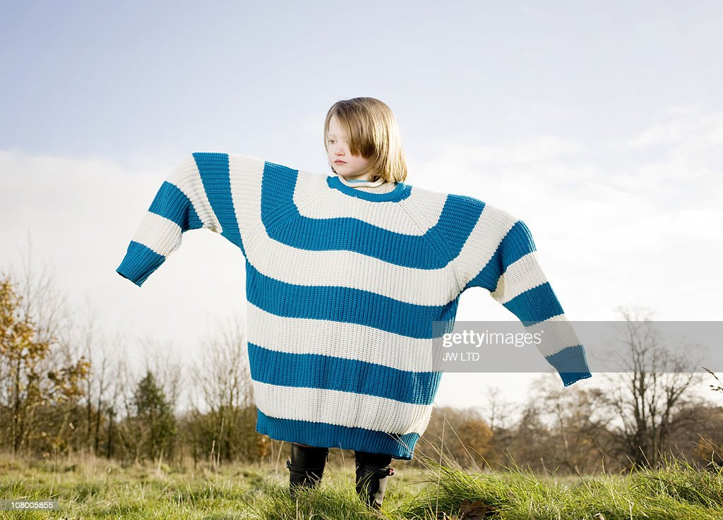 Girl wearing oversized jumper, arms out