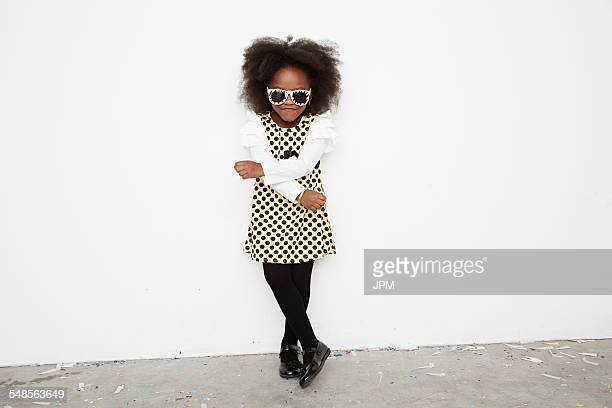 Girl wearing polka dot dress and sunglasses