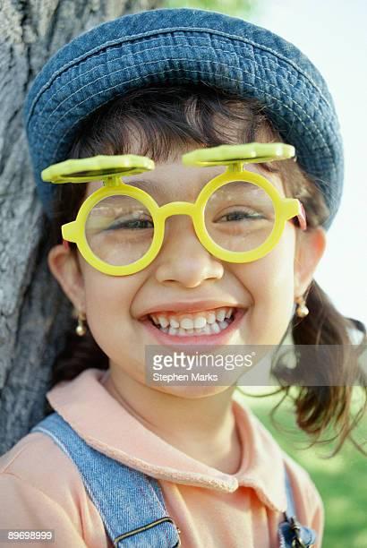 Girl wearing silly eyeglasses