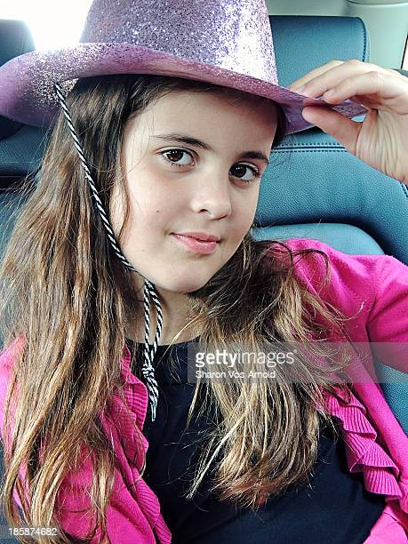 Girl wearing sparkly pink cowboy hat