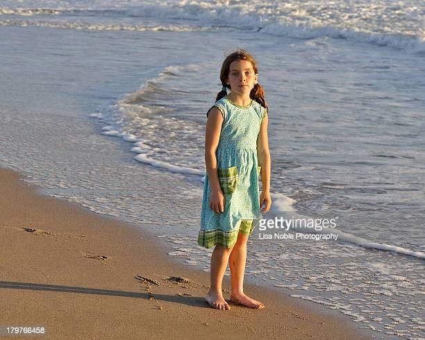 Girl  wearing sundress on beach at sunset