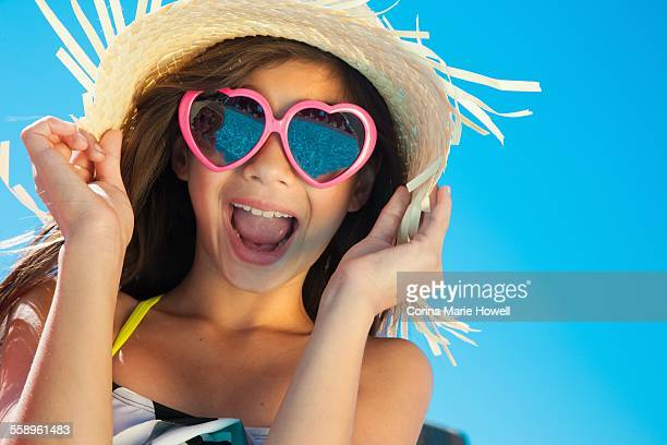 Girl wearing sunglasses and straw hat