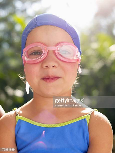 Girl wearing swimming goggles and cap (portrait)