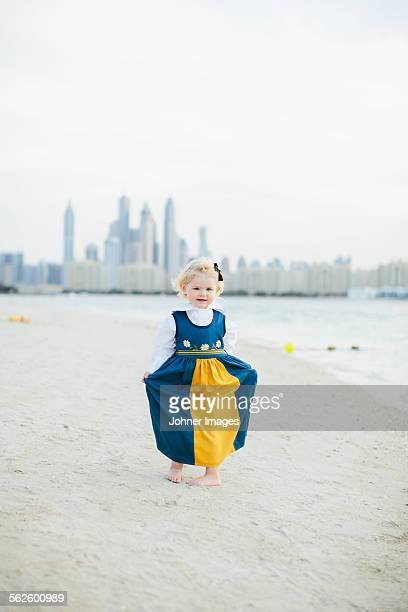 Girl wearing traditional dress on beach