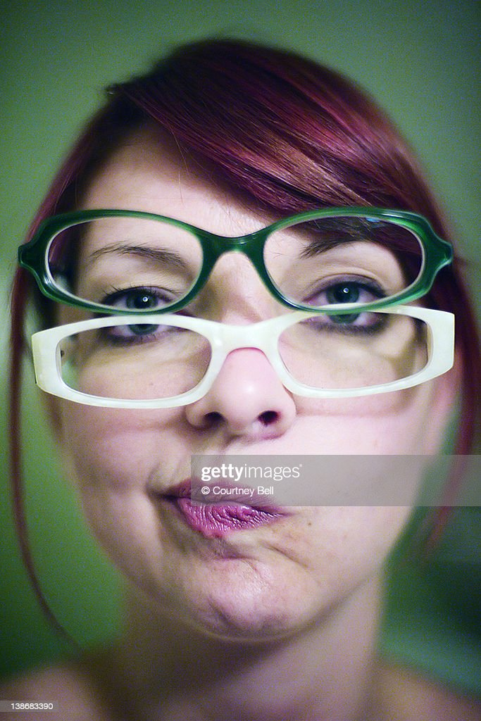 Girl wearing two pairs of glasses : Stock Photo