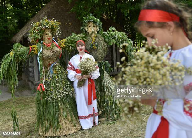 A girl wearing Ukrainian traditional clothes poses for a photograph during the celebrations of Ivana Kupala night an ancient heathen holiday in the...
