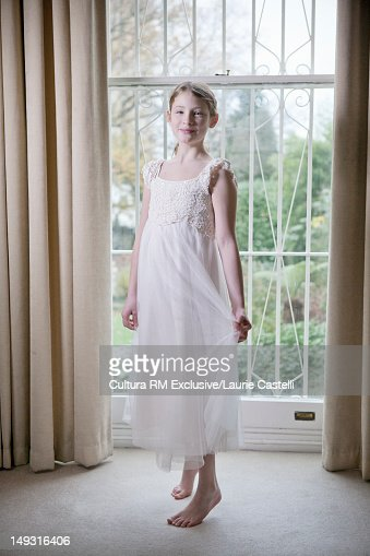 Girl wearing white dress indoors : Stock Photo