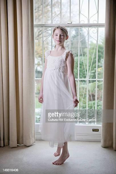 Girl wearing white dress indoors