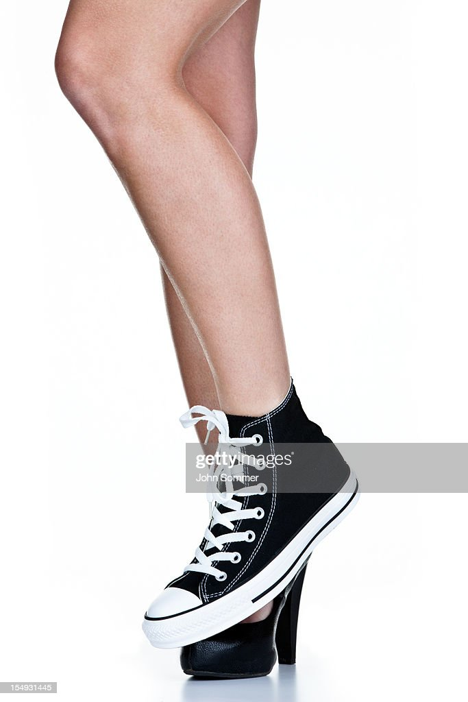 Girl wearing work shoe and a sneaker