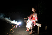 Girl wearing Yukata and playing with fireworks
