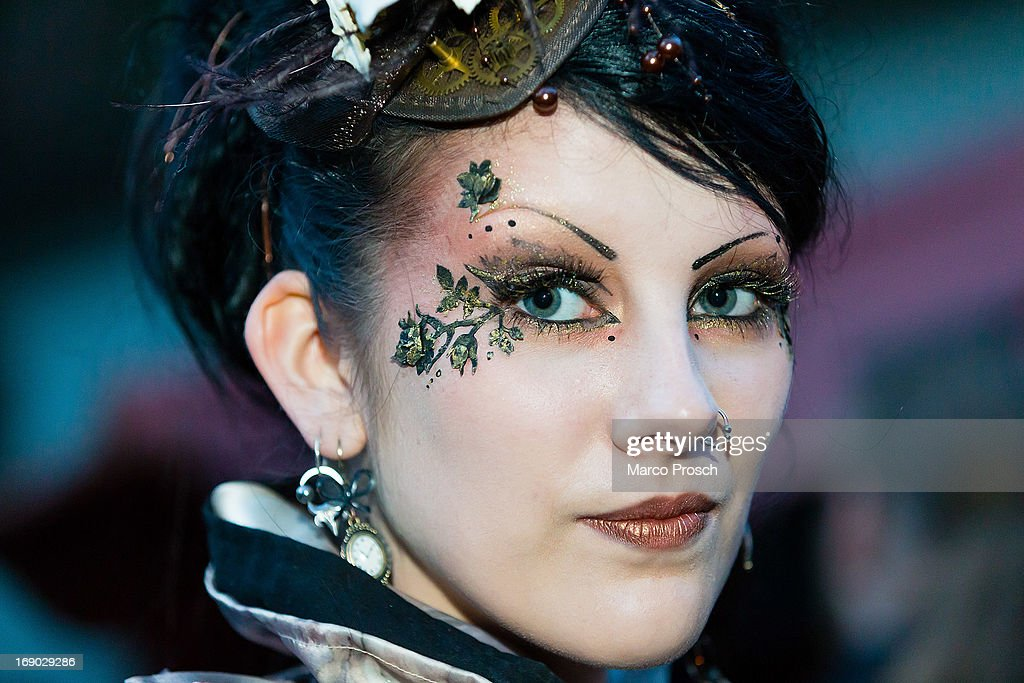 A girl wears flower make-up on the second day of the annual Wave-Gotik Treffen, or Wave and Goth Festival, on May 18, 2013 in Leipzig, Germany. The four-day festival, in which elaborate fashion is a must, brings together over 20,000 Wave, Goth and steam punk enthusiasts from all over the world for concerts, readings, films, a Middle Ages market and workshops.